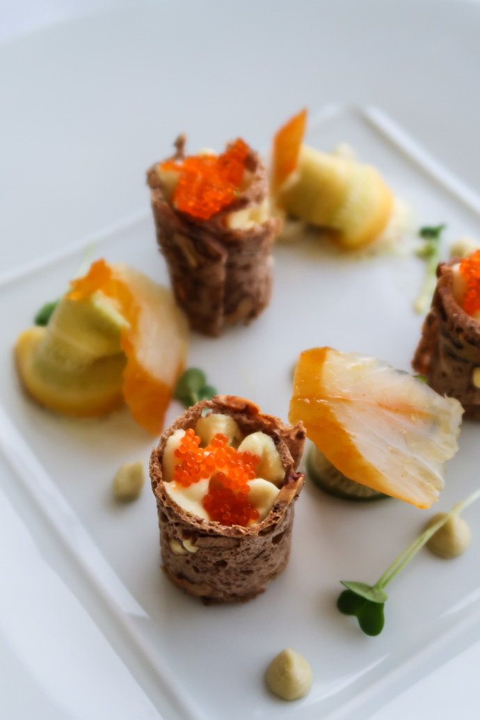 Entrée de poisson et crustacés au restaurant Tour des Vents